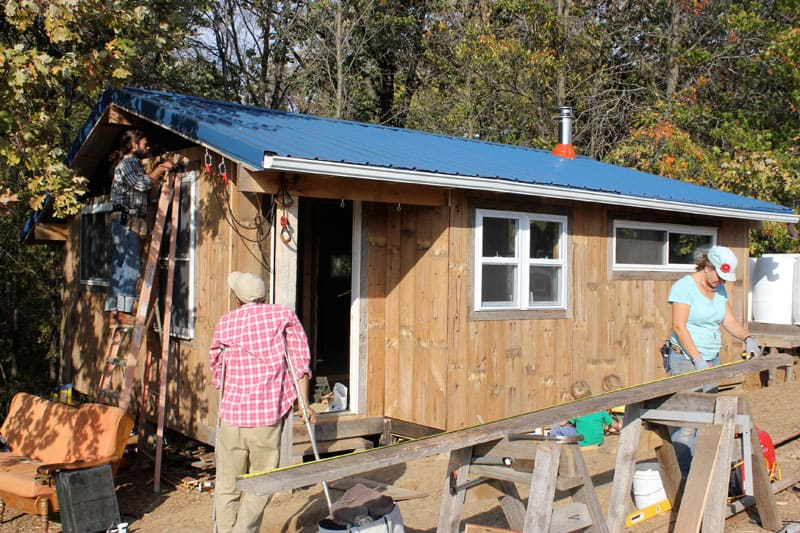 A work party to finish the insulation and siding on our 350 square foot tiny home (October 2013) | Homestead Honey