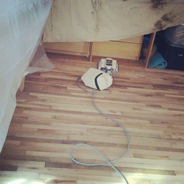 The hardwood floor sanding begins!