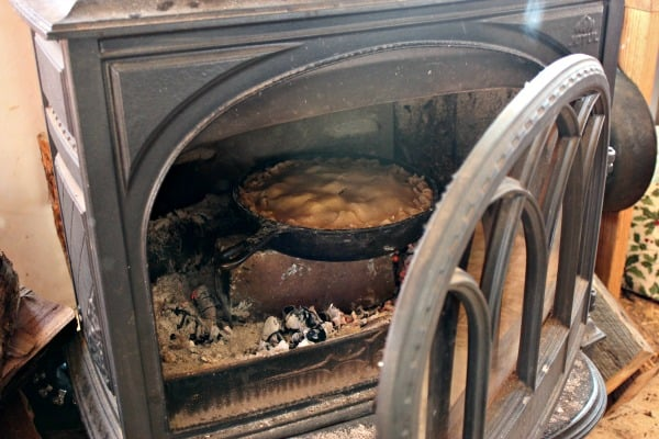 Don't have an oven? We don't either, and have come up with some ways to bake. This pie is about to bake in our wood stove! | Homestead Honey
