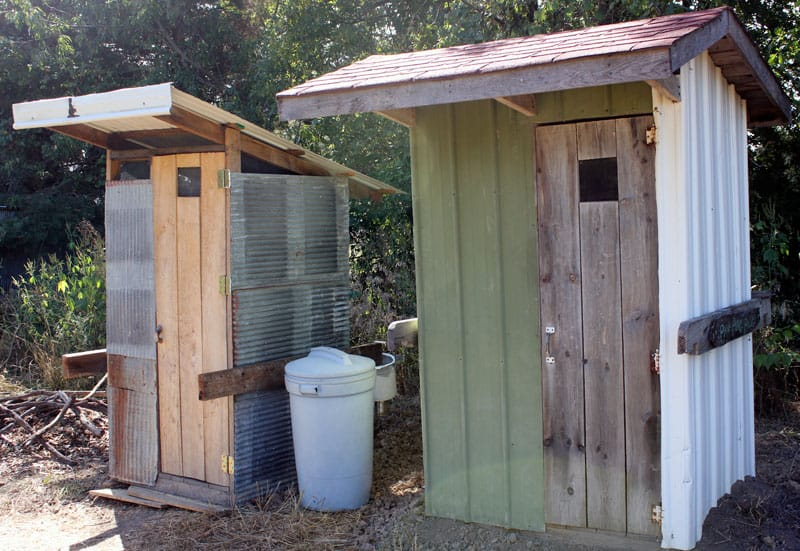 Two pit latrines at the Possibility Alliance, in Northeast Missouri. When the pits are full, they will be covered in topsoil, and allowed to decompose. In a few years, a fruit tree might be planted into the rich soil that has been created.