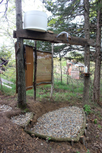 A homestead outdoor shower set up to work without running water | Homestead Honey