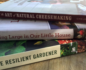 Looking for a few homesteading books and eBooks to enjoy reading this summer? Here are book reviews of a few excellent homesteading and gardening selections. | Homestead Honey