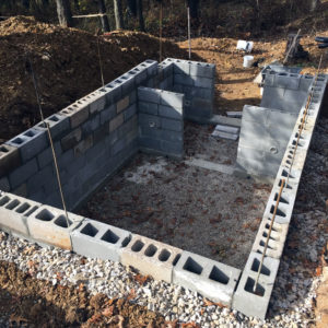 Building the concrete block walls of our homestead root cellar | Homestead Honey