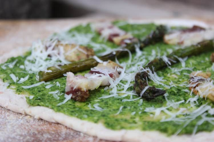 Spring pesto tops homemade pizza.