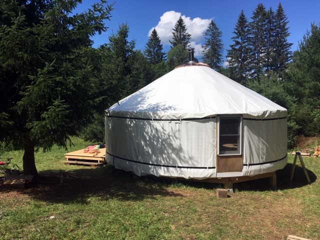 Our almost finished yurt, showing one of the hard windows
